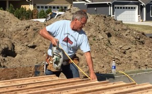 "Jon helping to build a home in the new ""self help"" neighborhood on South Church Road"